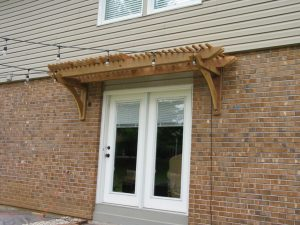 Pergola above sliding door
